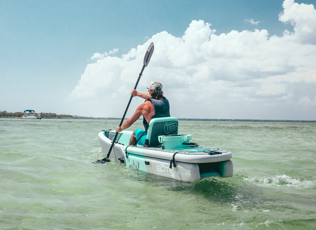 The LONO inflatable kayak is a sit-on-top kayak with a self-bailing cockpit