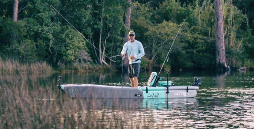 Man standing and fishing from his BOTE LONO Aero inflatable fishing kayak.