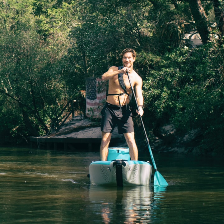 BOTEs inflatable kayaks, transform into a stand up paddle board in seconds. Man SUP paddling the DEUS Aero