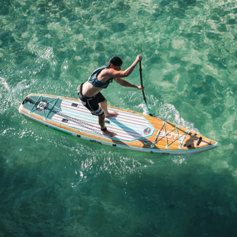 Man training for paddle racing on the BOTE Traveller Aero inflatable paddle board