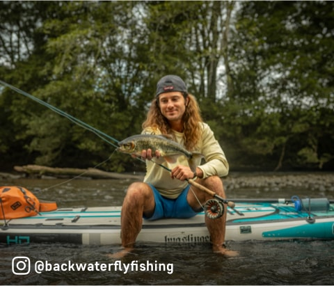Micah Baly shows off his catch from his BOTE HD Aero Bug Slinger™ inflatable paddle board, Backwater Fly Fishing