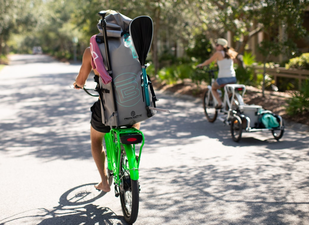 Taking Pedego bikes to the beach to paddle.