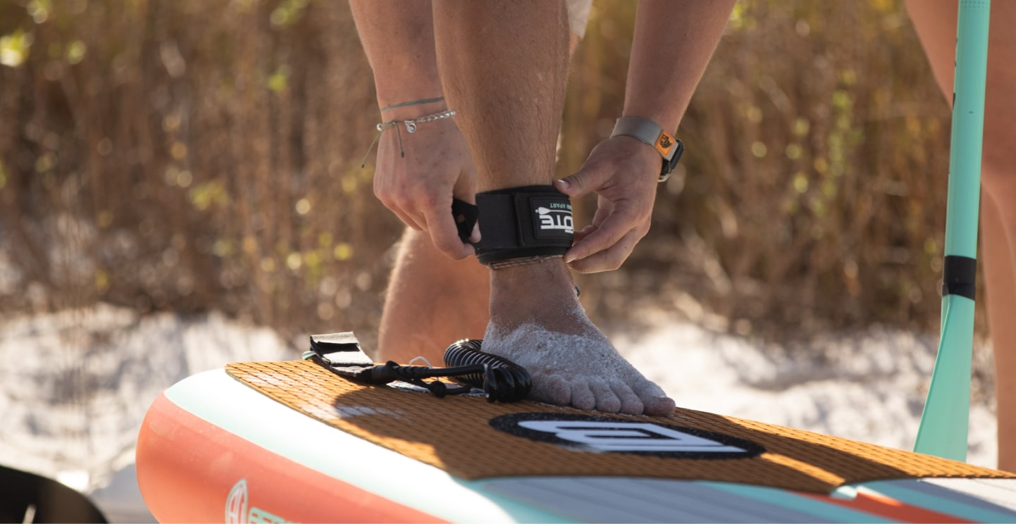 Attach the leash cuff to you before heading out into the water.