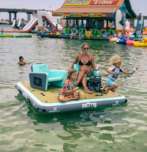 Family enjoying a day at the sandbar on the BOTE inflatable Dock 7
