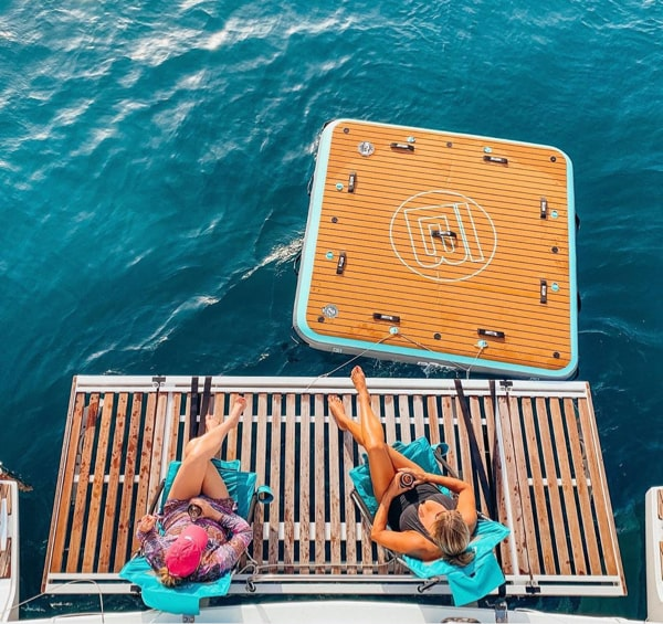 Use the BOTe inflatable swim platform, the Dock 7, to float off the back of your boat. Photo by Karma Yachting