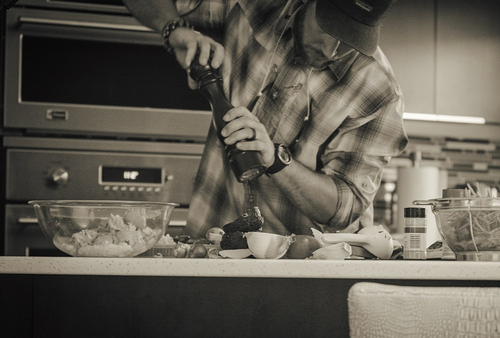 Drew prepping a new gourmet meal from his latest catch and his personal garden.
