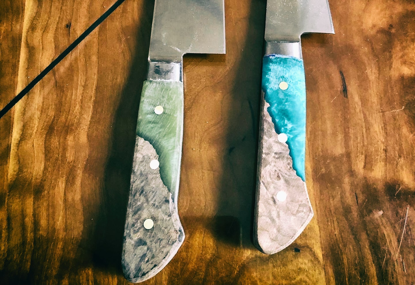 Custom hand-crafted knives, courtesy of Drew's metalworking talents.