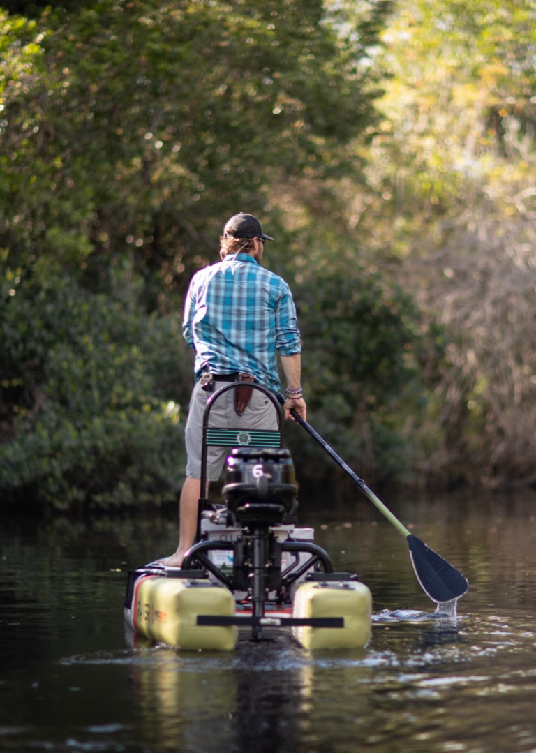 Drew creeping up close to cast a line in a favorite fishing spot.