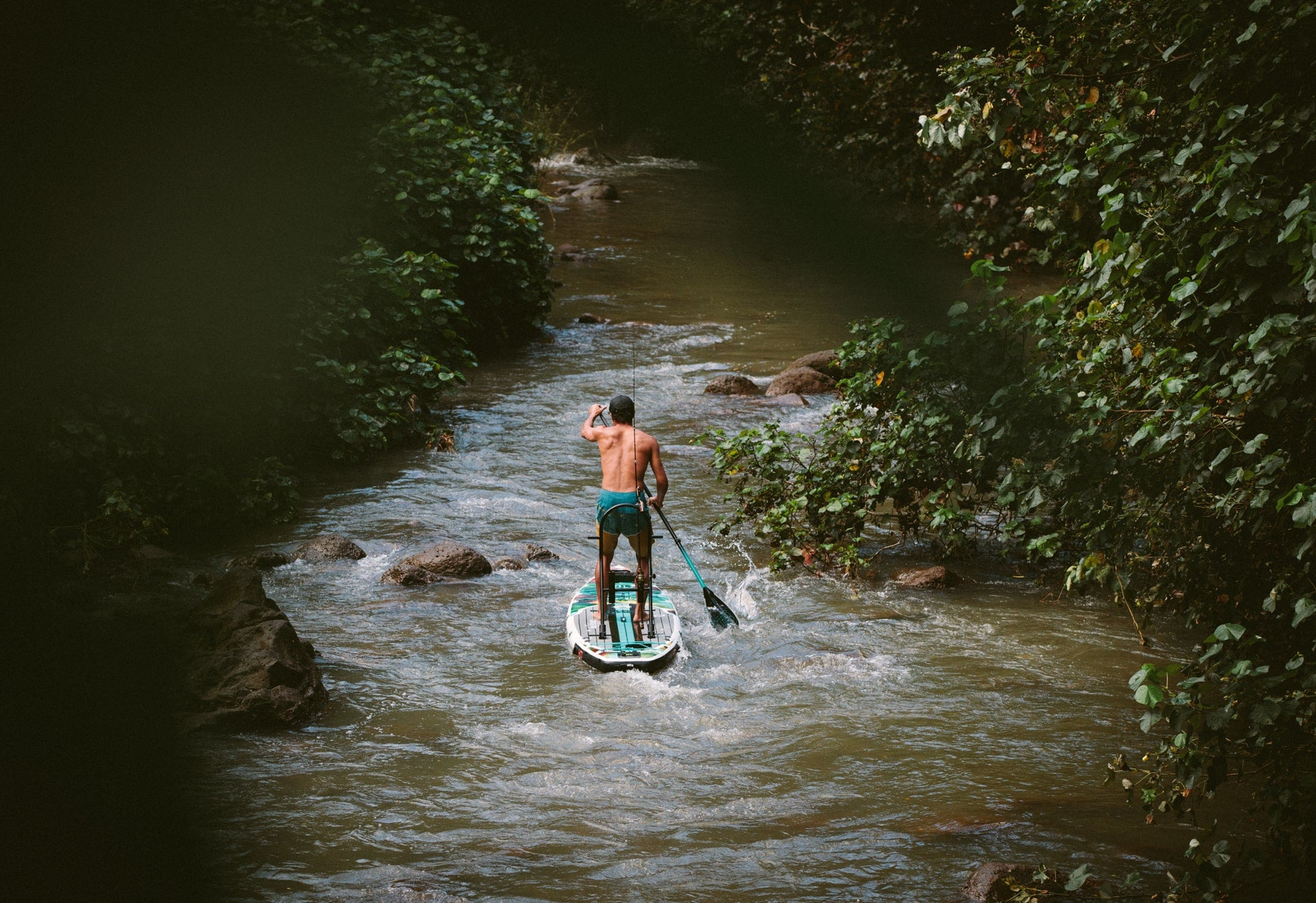 taloa crusing down river on a BOTE HD inflatable paddle board