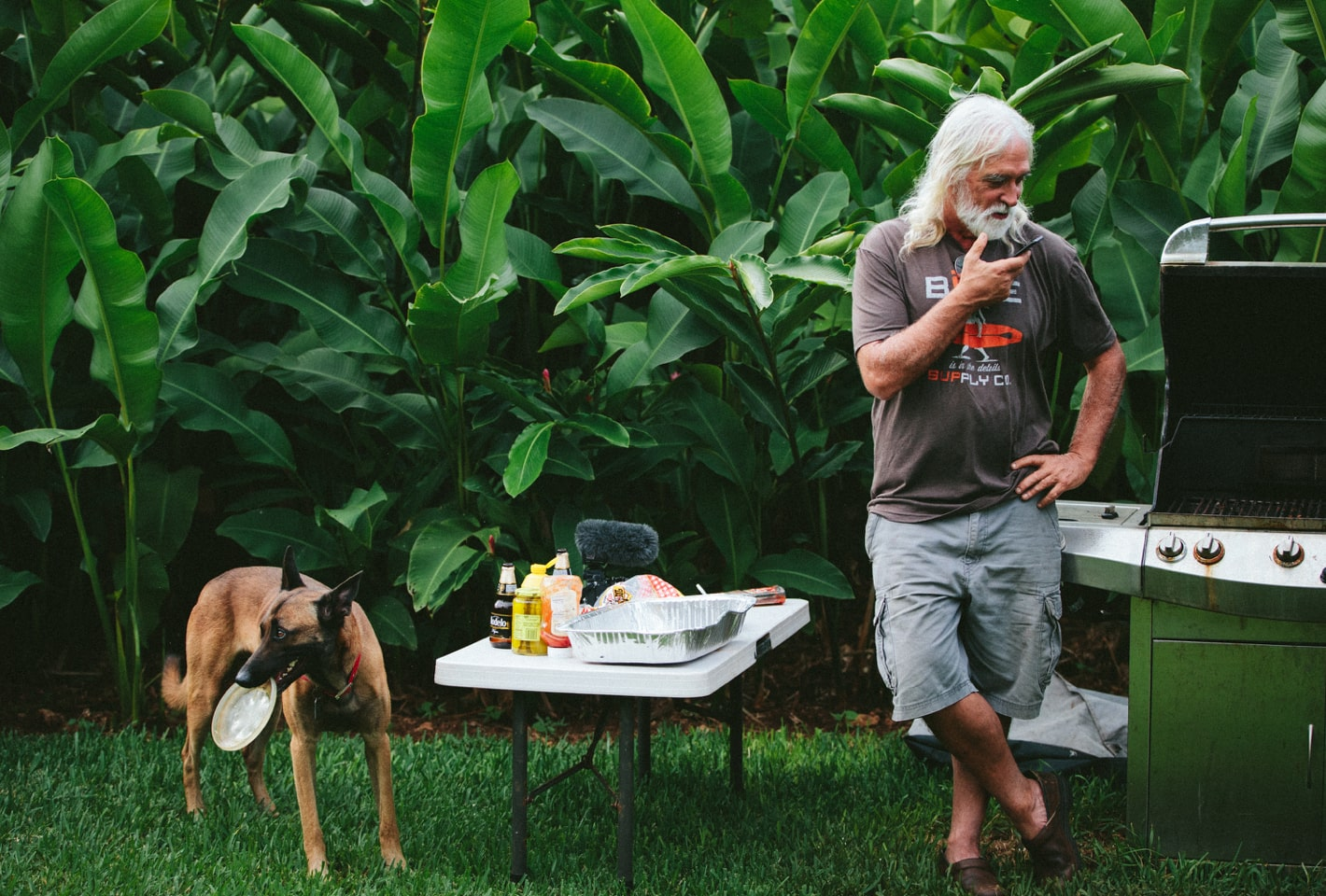 man and dog grilling out