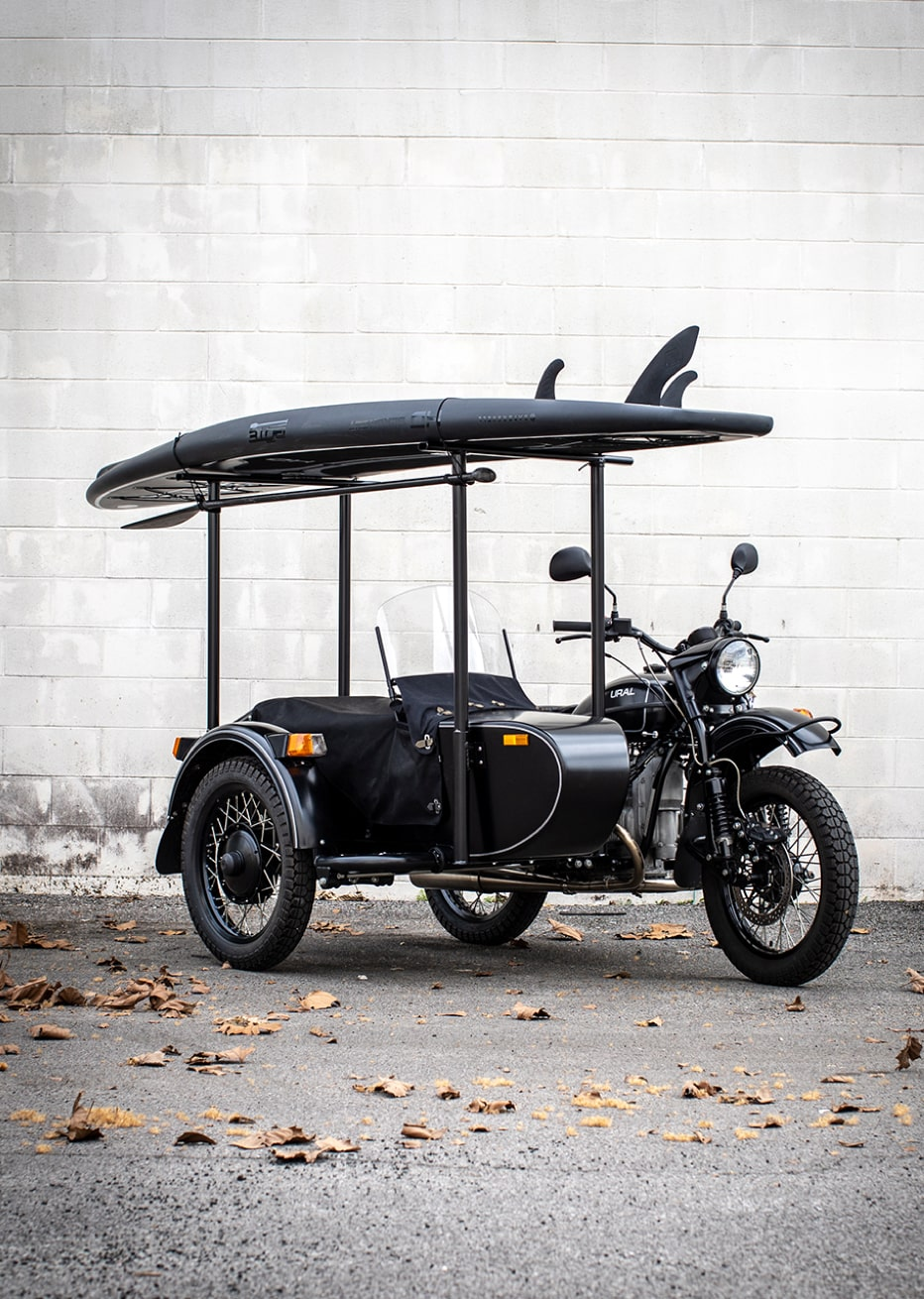 ural motorcycle with blackout HD paddleboard and sidecar