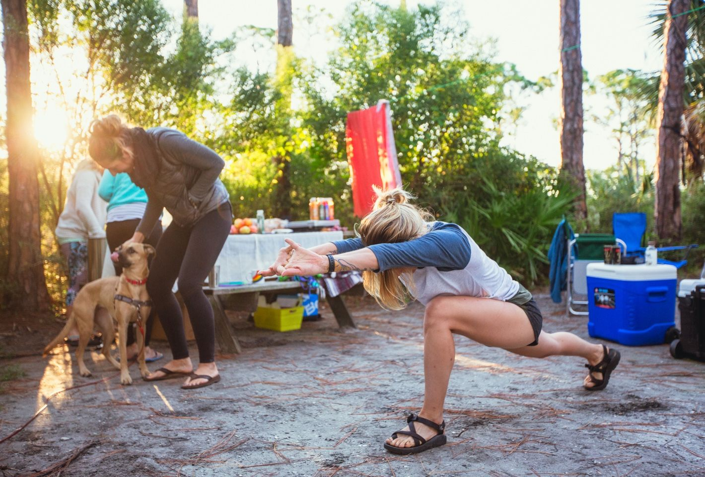 woman lunging at campsite