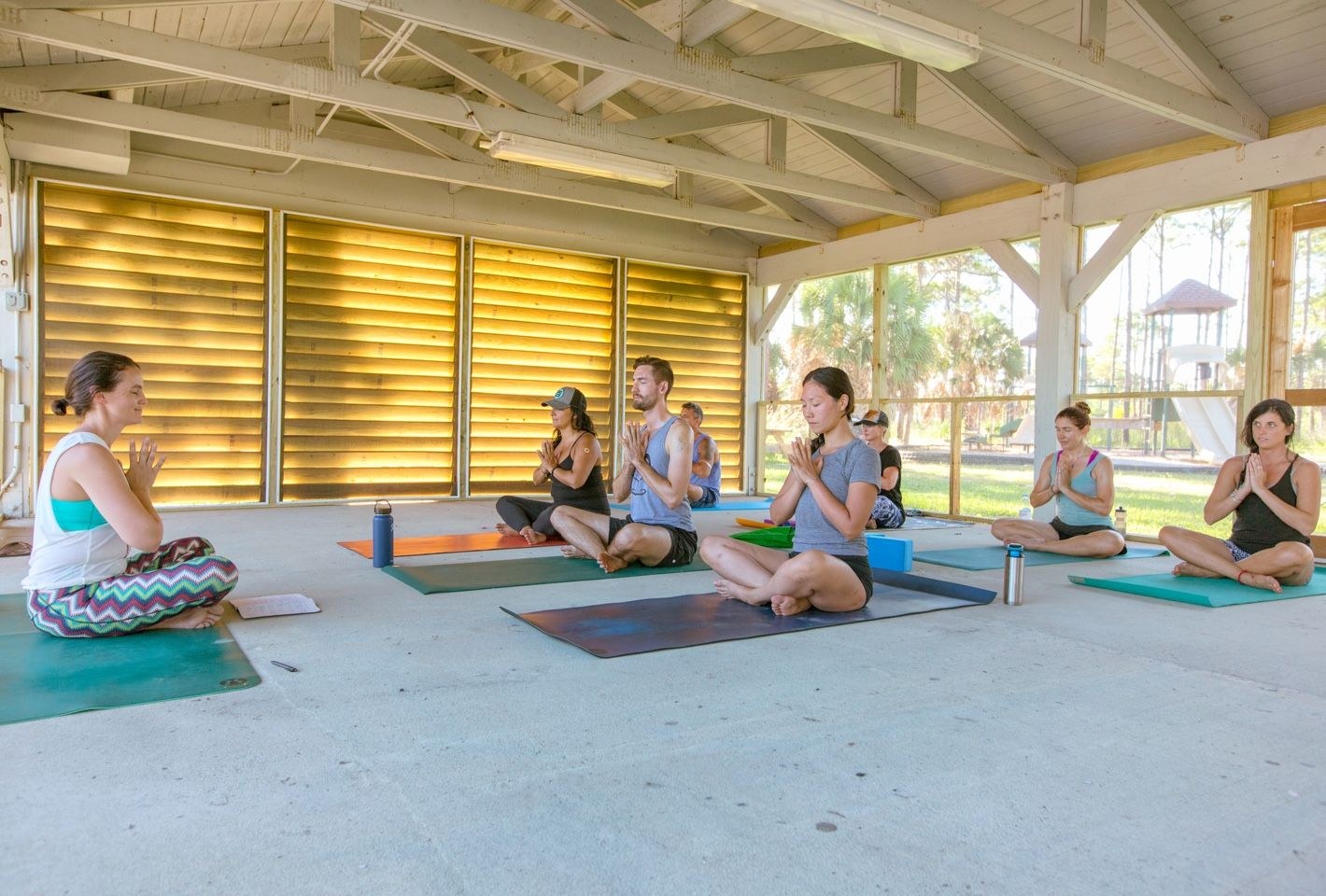 yoga class in seated position at park