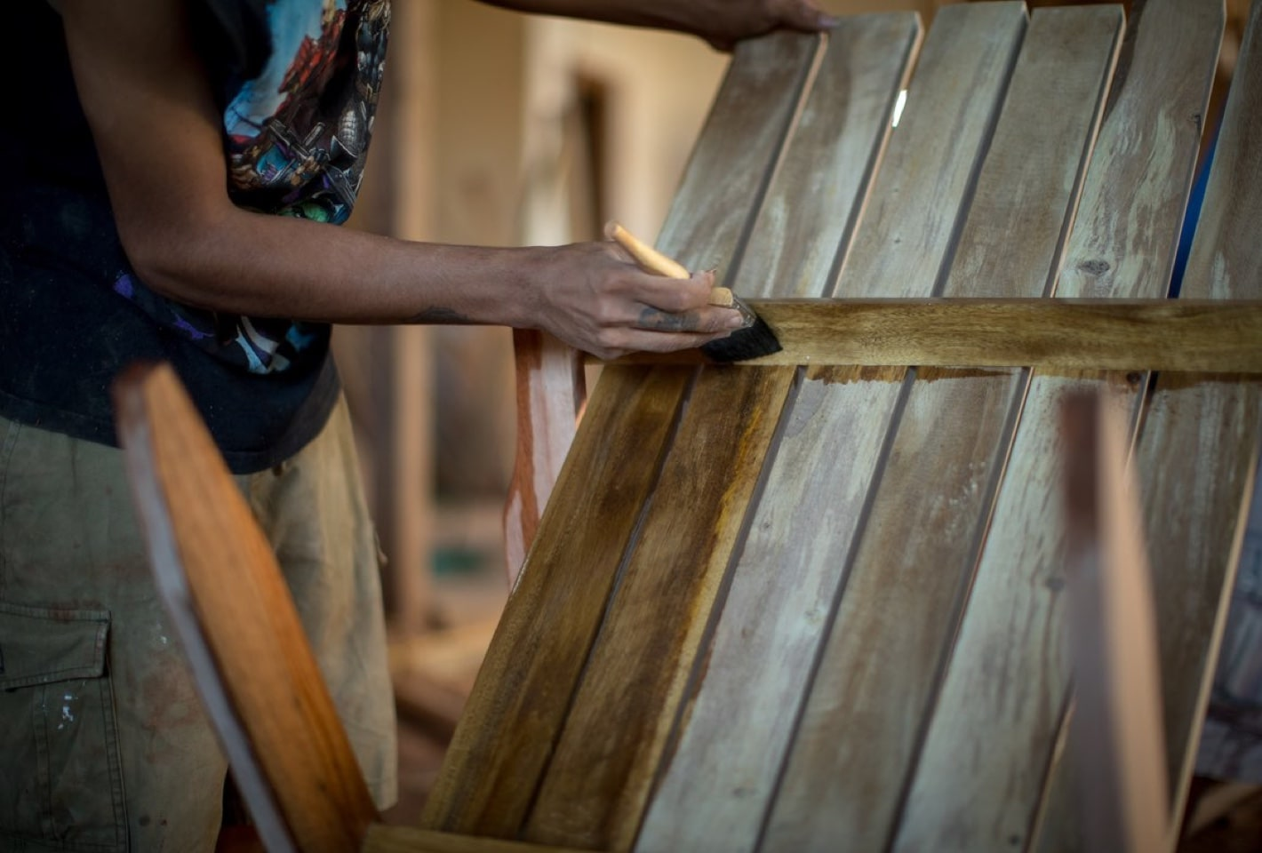 Local workers helping furnish the BOTE House Belize