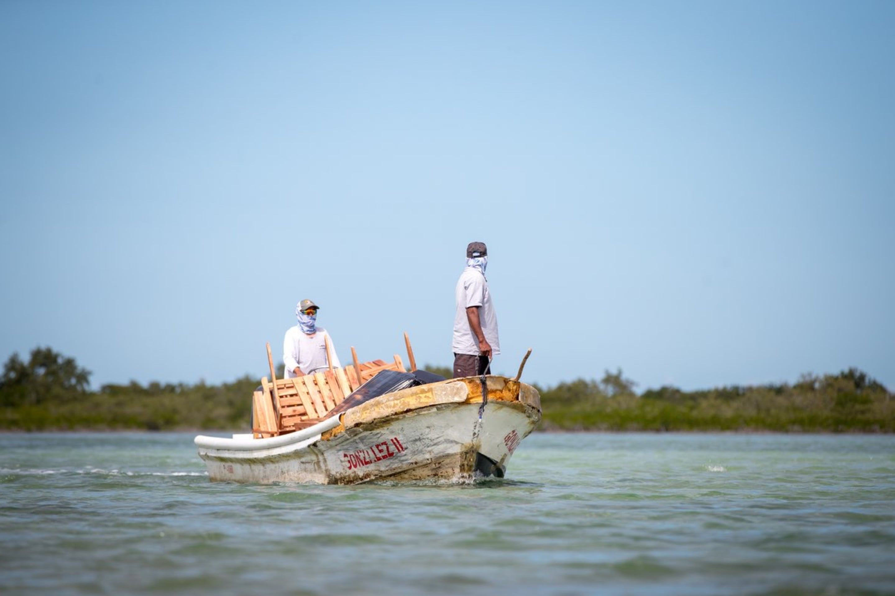 Local wood workers delivering furniture for the BOTE House Belize