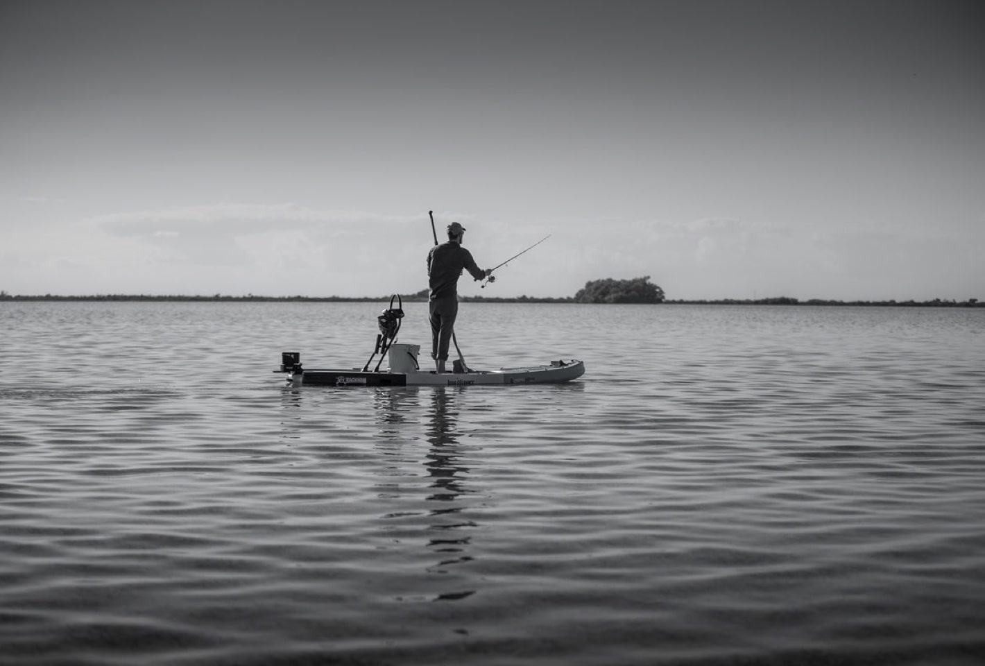 Fishing off a Bug Slinger™ BOTE Rackham inflatable paddle board in Belize flats