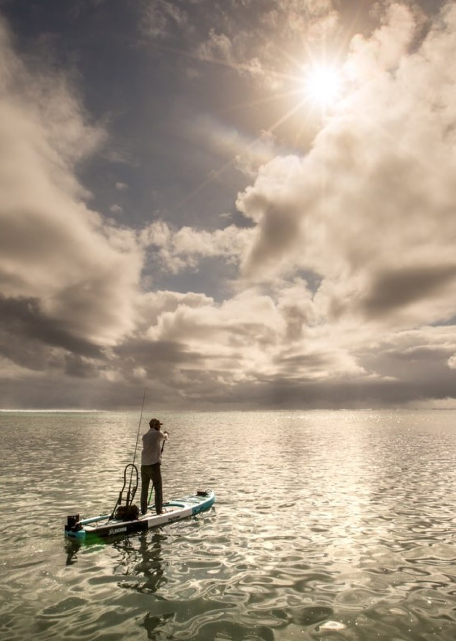 Fishing off a Bug Slinger™ BOTE Rackham paddle board in Belize flats