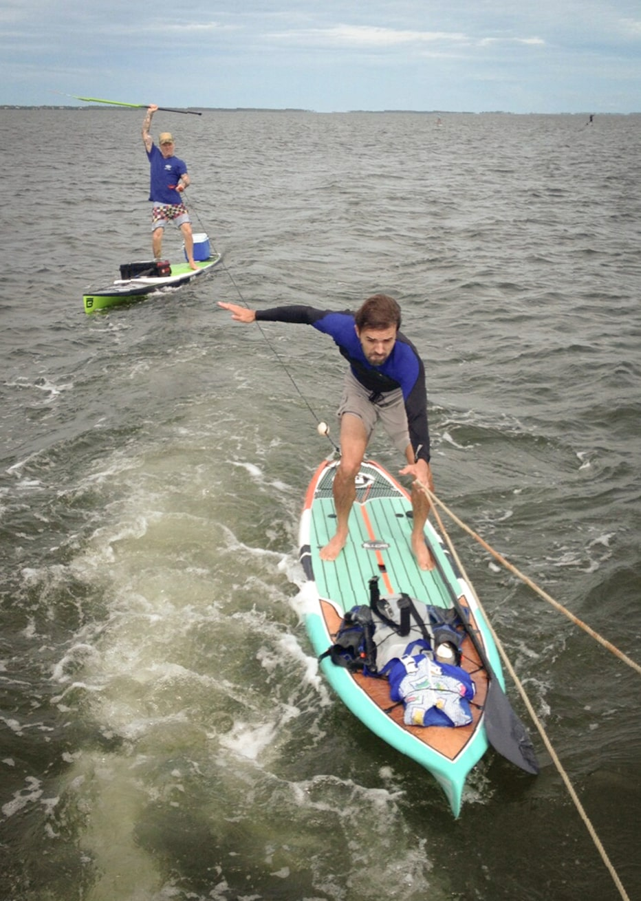 Two Guys Skiing on BOTE Paddle Boards