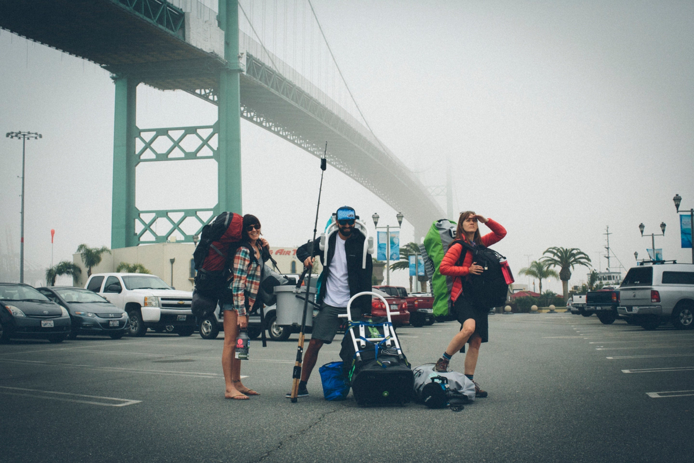 Group posing with their gear under Vincent Thomas Bridge, Los Angeles Harbor, California