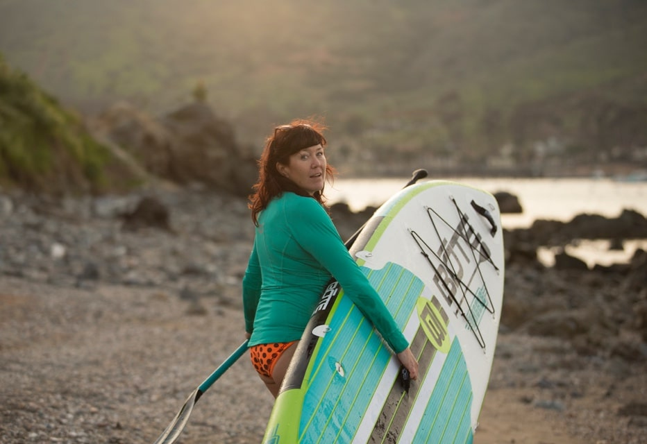Erin taking her BOTE inflatable paddle board down to the coast