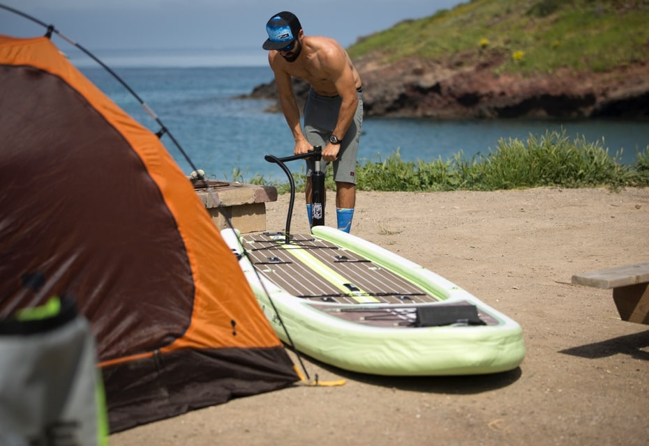 Komron inflating his BOTE inflatable paddle board