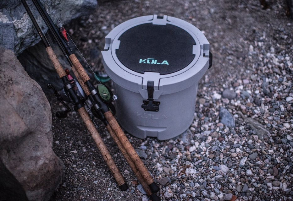 Fishing poles and a KULA 5 Cooler