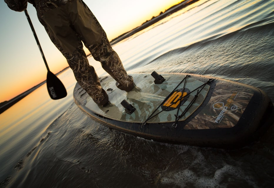 sunset paddle on BOTE camo inflatable paddle board
