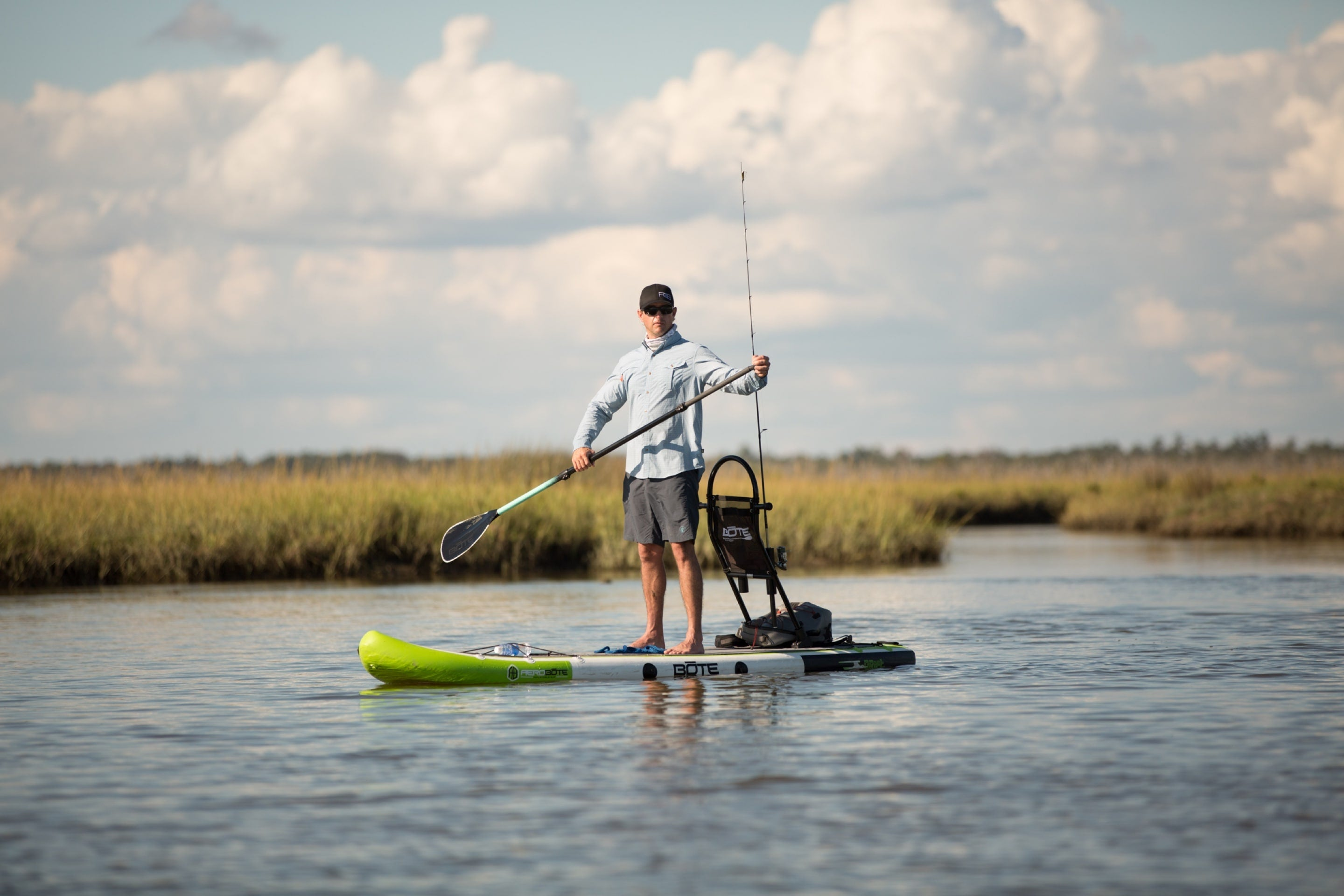 Man looking for fishing spot on BOTE inflatable paddle board