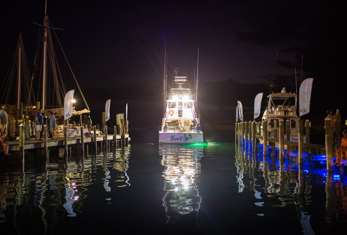 Fishing boat leaving Destin harbor at night
