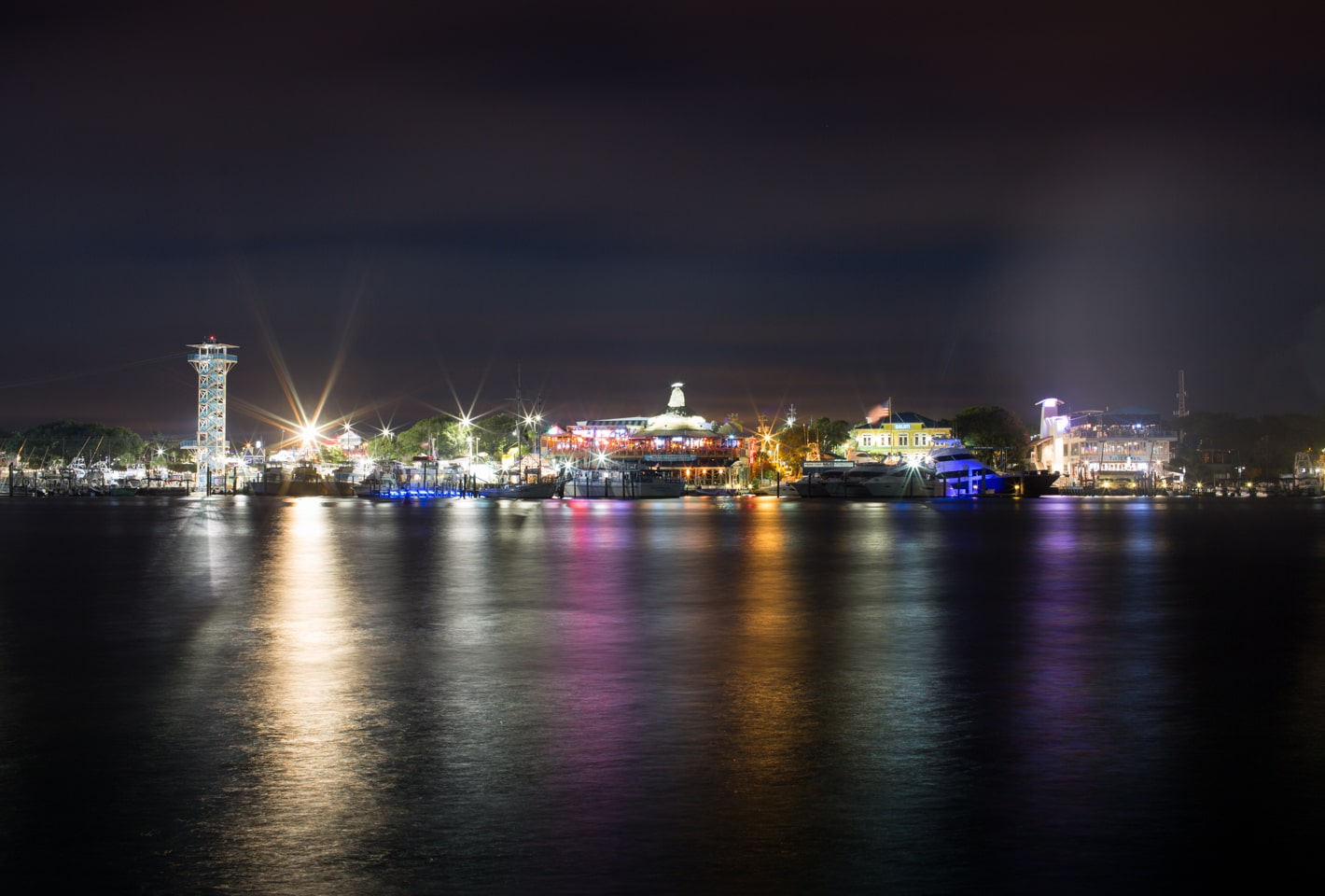 Destin, Florida harborwalk lit up at night