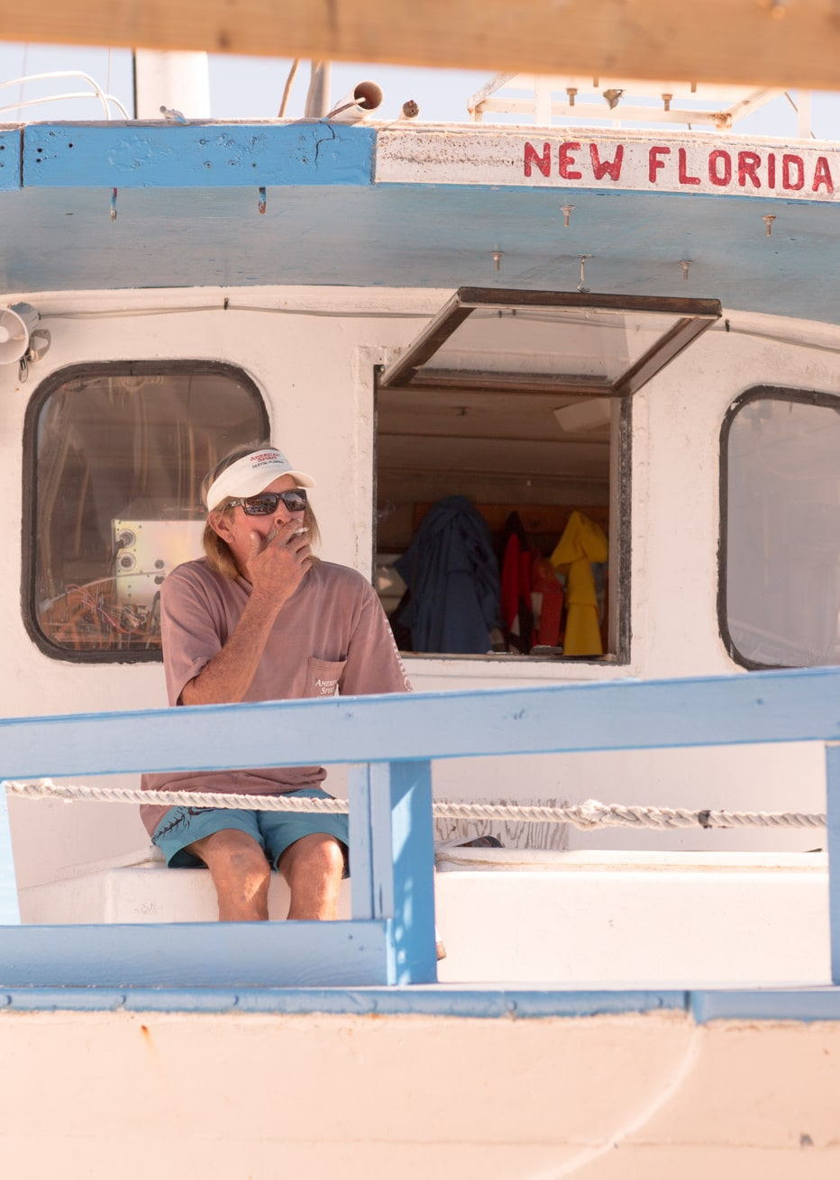 Fisherman taking a smoke break on the New Florida Girl boat