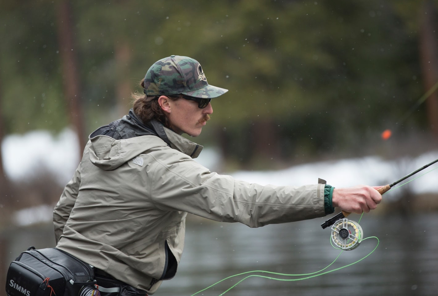 Landon in river fly fishing