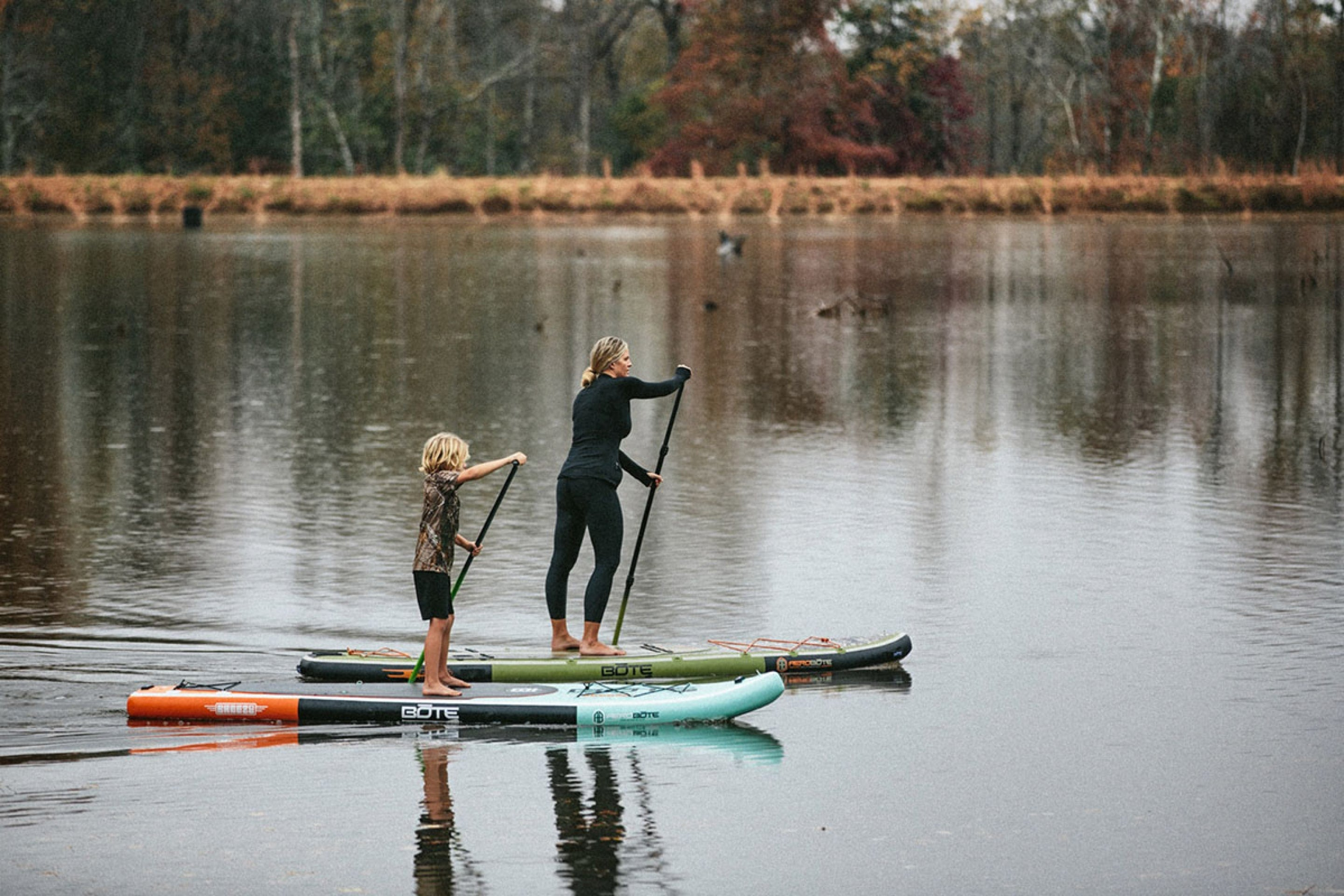 Mom and son using BOTE paddle boards