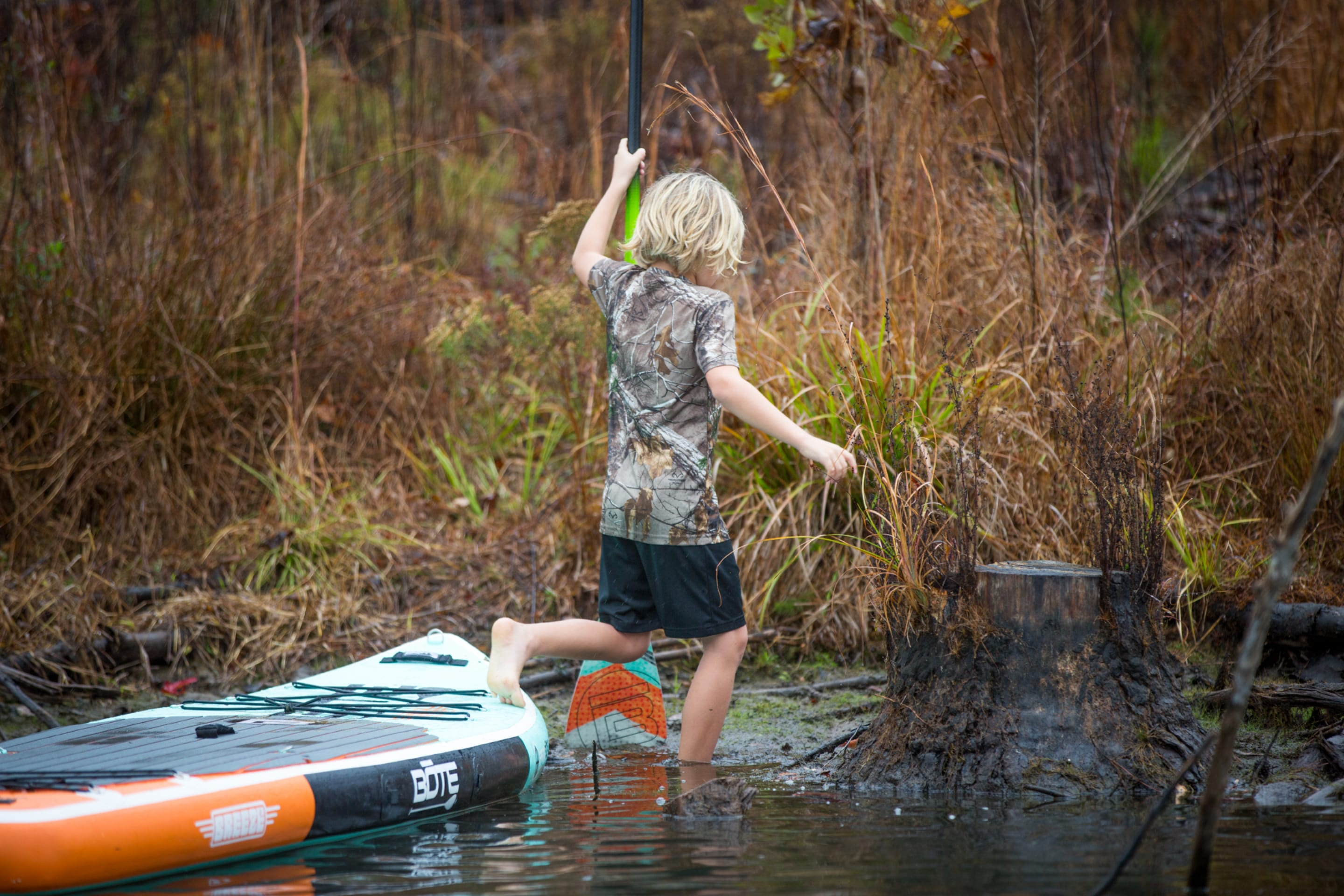 Boy using inflatable BOTE paddle board