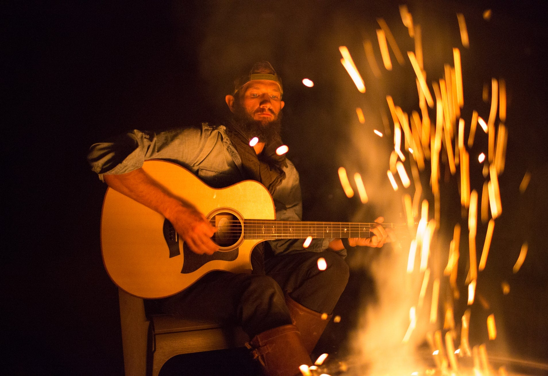 Playing guitar by the fire