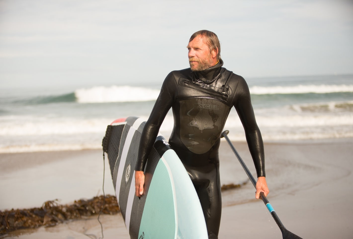 Surfer with BOTE Grambler Paddle Board
