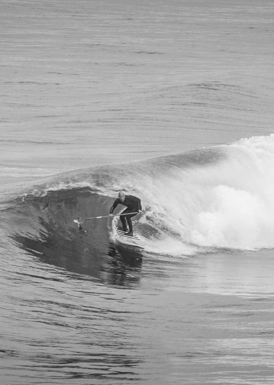 9eed9db9da4a Man surfing on west coast on BOTE paddle board