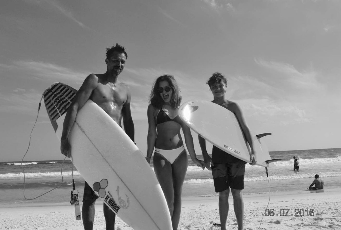 Harry and Kids at beach with surfboards