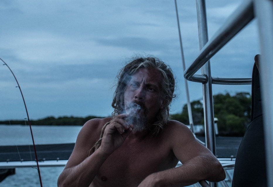 guy smoking on boat in keys