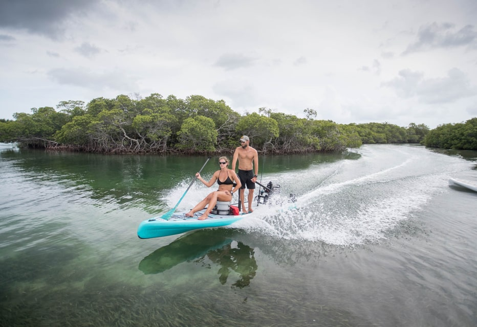 couple riding on microskiff the BOTE rover in keys