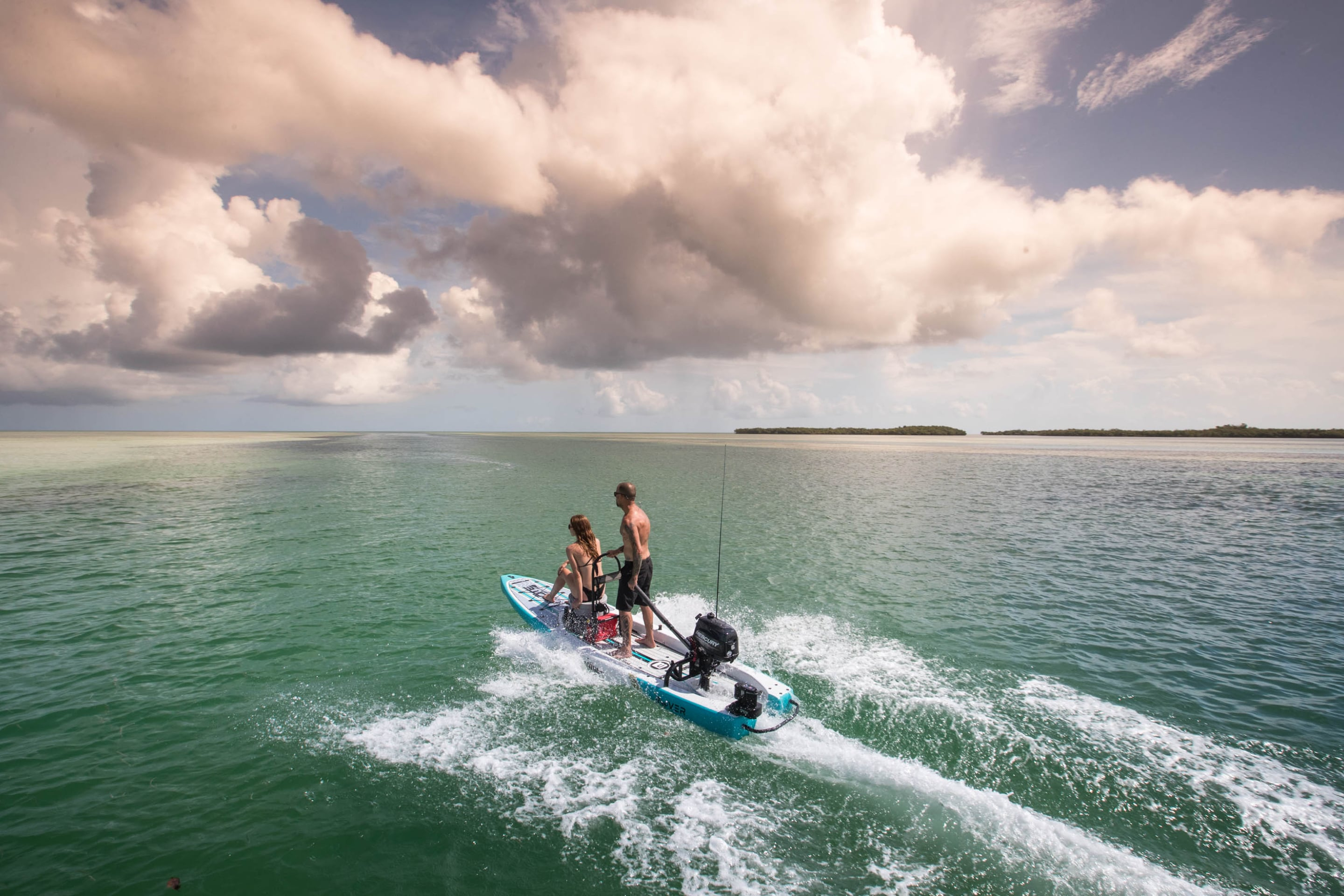 couple riding microskiff the BOTE rover around the keys