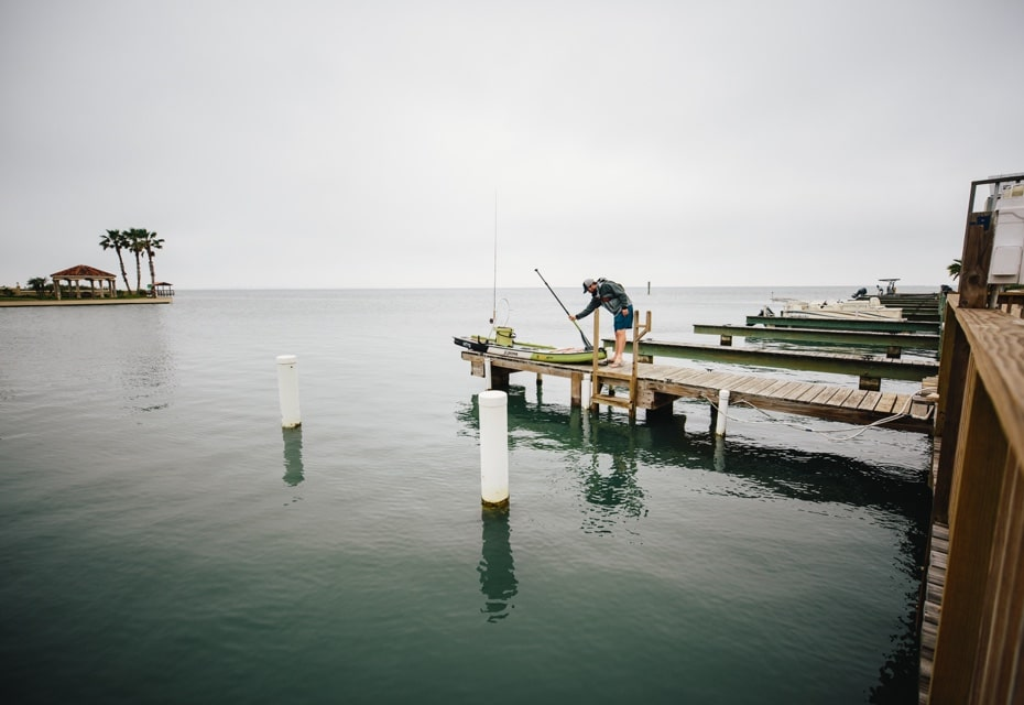 launching BOTE paddle board from dock