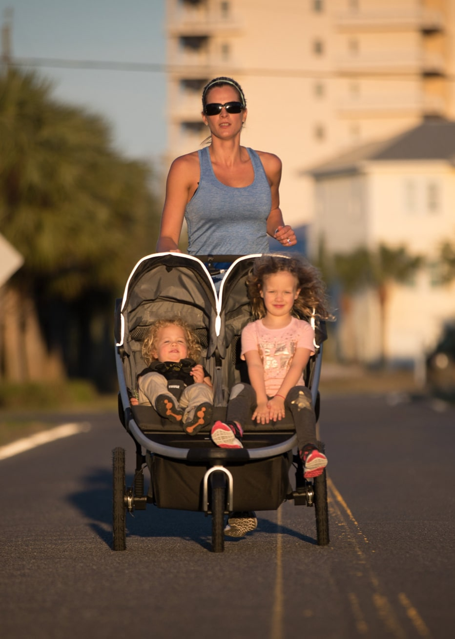 Magda running with kids in stroller