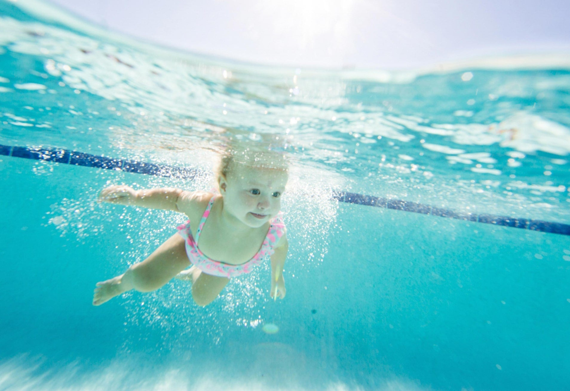 baby swimming in pool