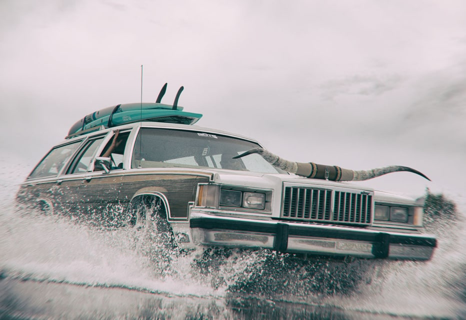 Station wagon outfitted with bull horns and BOTE paddle boards