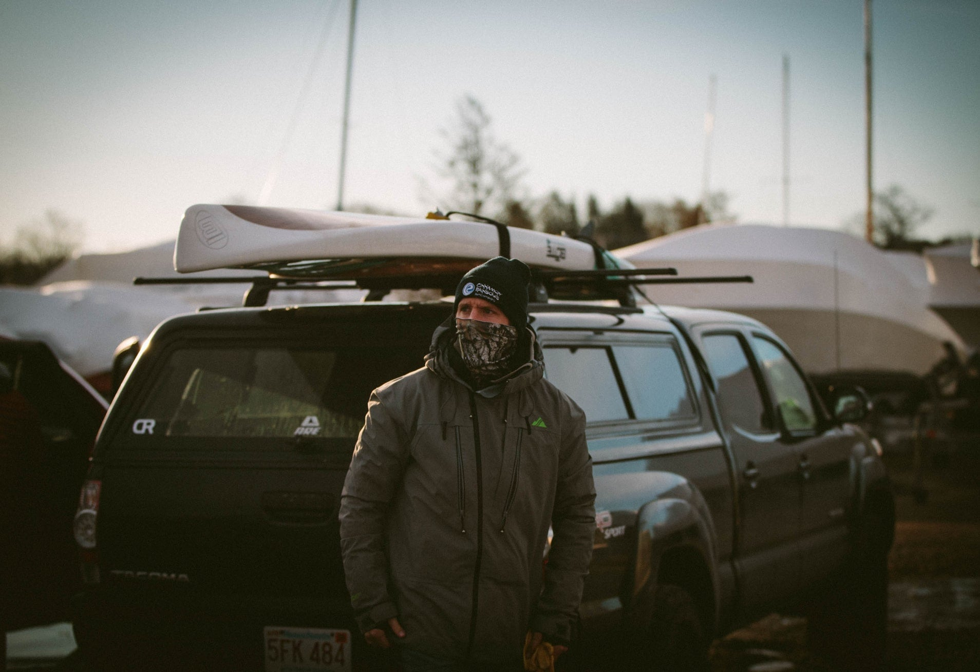 Willis Brown next to Toyota Tacoma with BOTE Rackham Paddle Board on roof