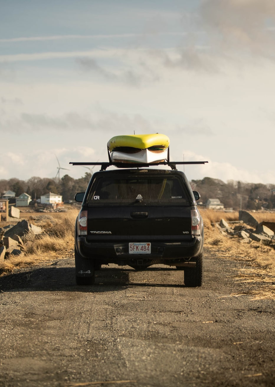 Toyota Tacoma driving with BOTE Paddle boards on roof
