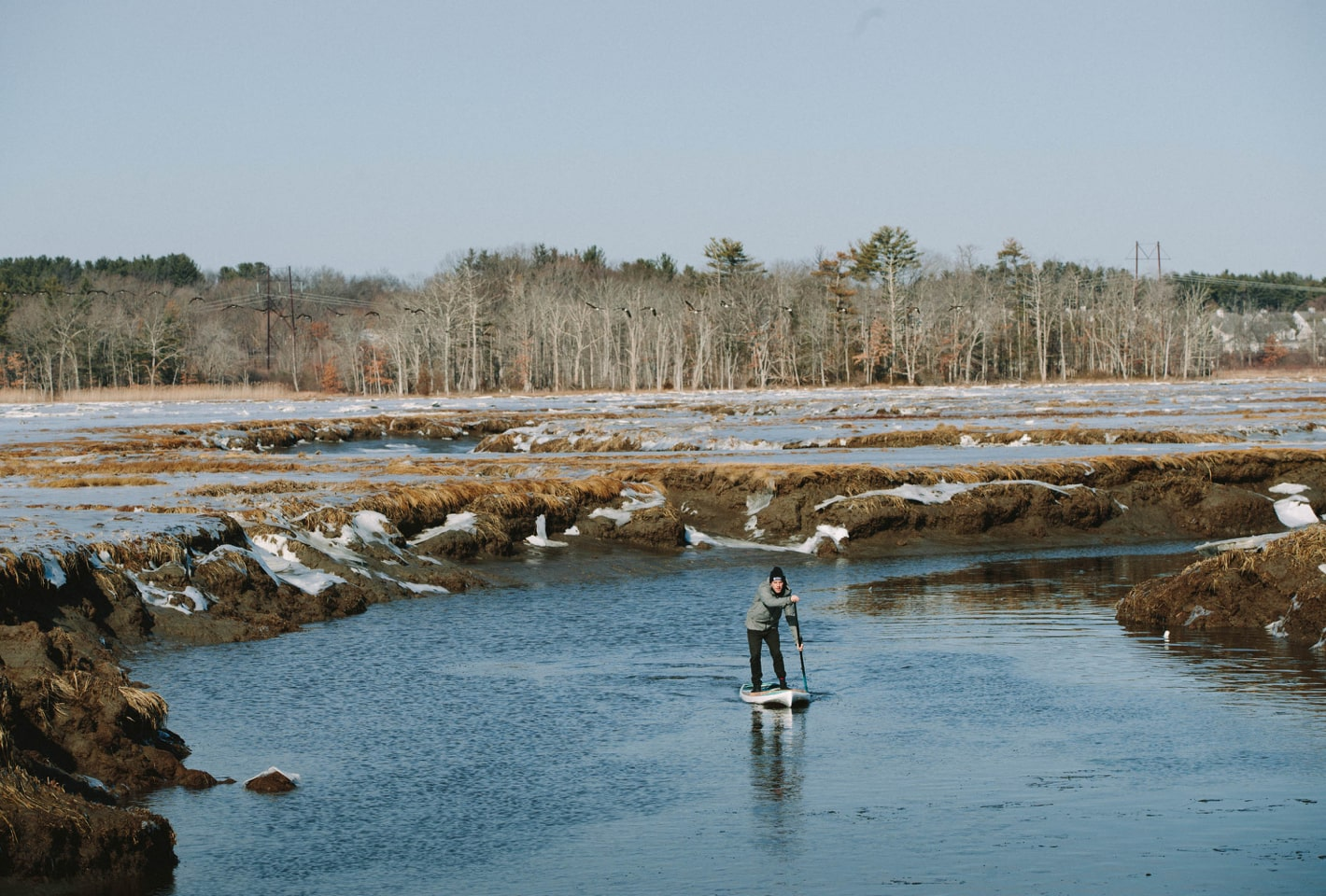 Willis Brown paddling BOTE Rackham paddle board down snowy river