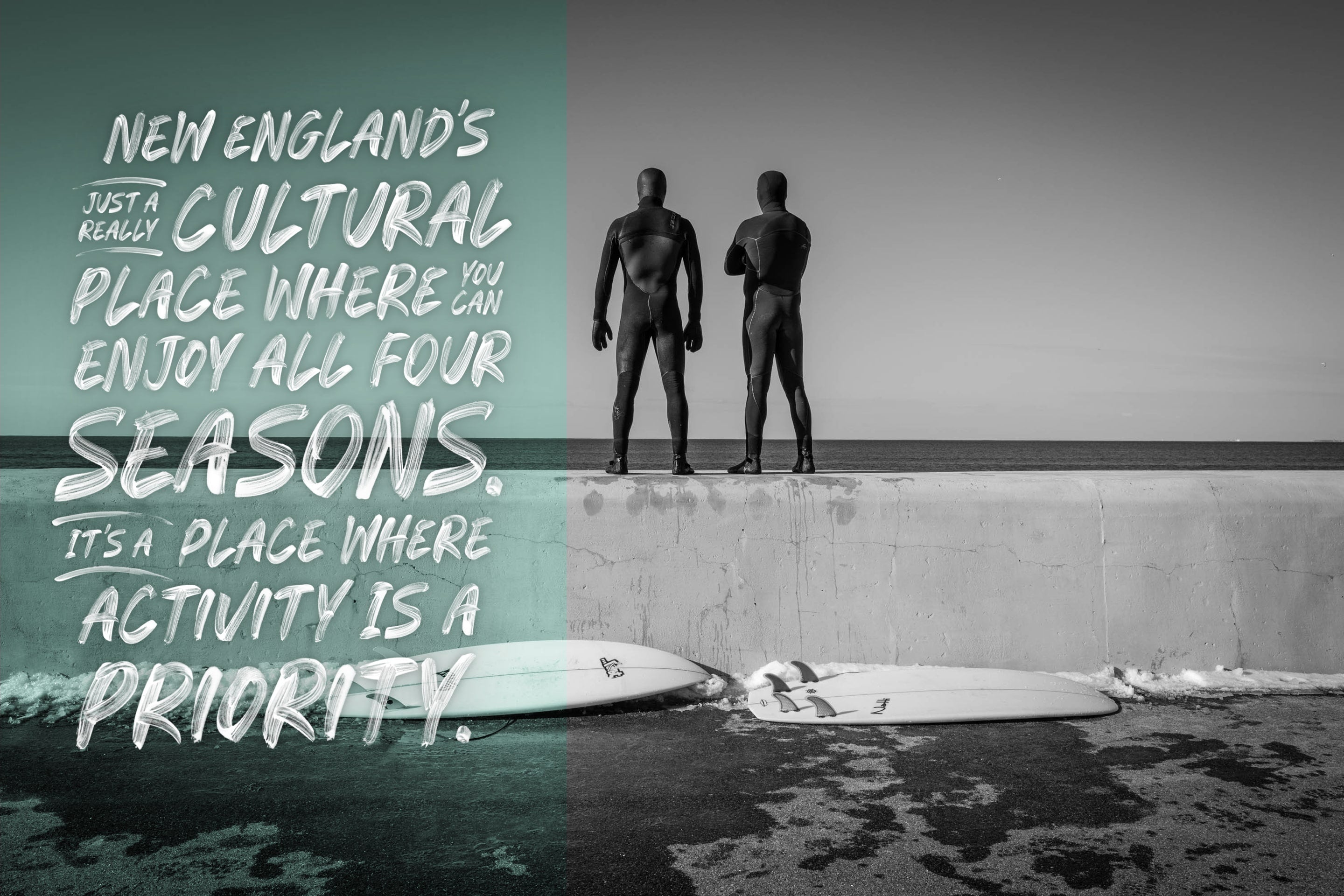Two men in wetsuits standing on wall after surfing