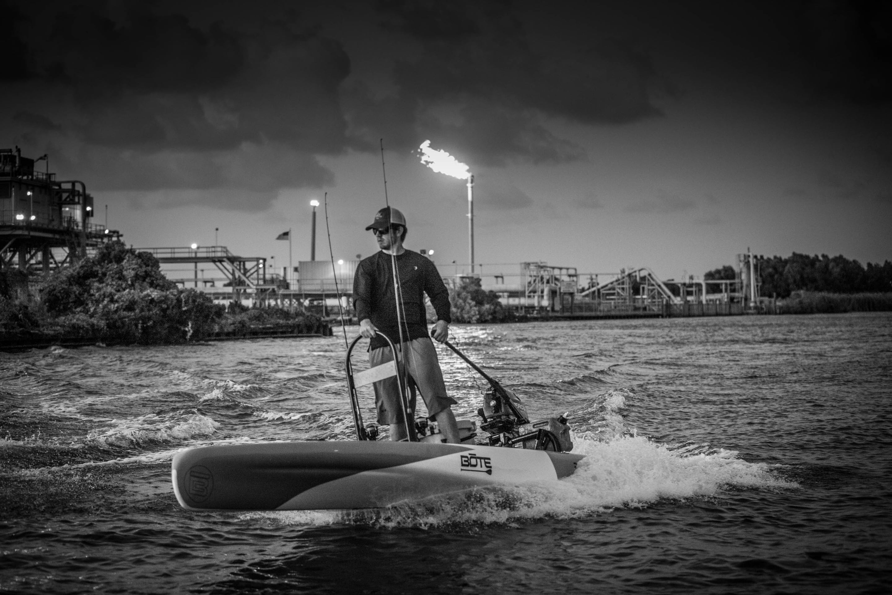 Brown Frenette taking his BOTE Rover microskiff out on the Venice, Louisiana waters in front of refineries